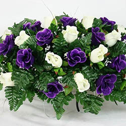 purple and white roses silk flower cemetery tombstone saddle