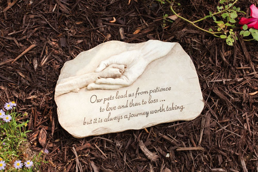 paw in hand dog memorial stone